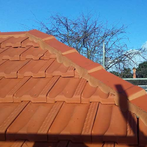 Rehua Roofing red tiles- specialises in concrete tile installation, roof restoration and maintenance