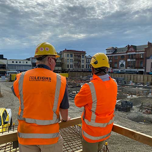 Work men in high vis jackets surveying for Rehua Reo Contracting